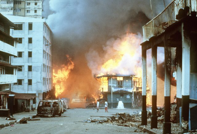 Flames engulf a building following the outbreak of hostilities between the Panamanian Defense Force and U.S. forces during Operation Just Cause.